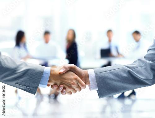 Leinwanddruck Bild Close up of businessmen shaking hands