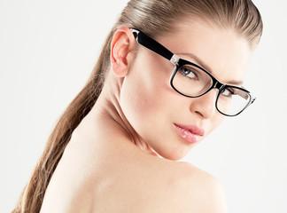 Beauty portrait of pretty girl wearing stylish eyeglasses