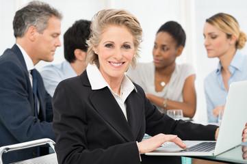 Mature Businesswoman Using Laptop
