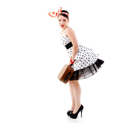Pinup girl with suitcase in dress spotted, full length retro por