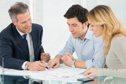 Young Couple Buying A New House - 66187241