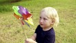 Boy playing pinwheel park