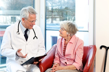 Male doctor in consultation with a senior patient.