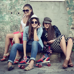 Girls having fun together outdoors, urban lifestyle