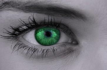 Bright green eye on female face