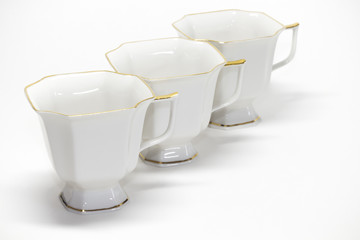 Three porcelain coffee cups in a row