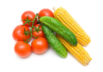 tomatoes, cucumbers and corn isolated on white background