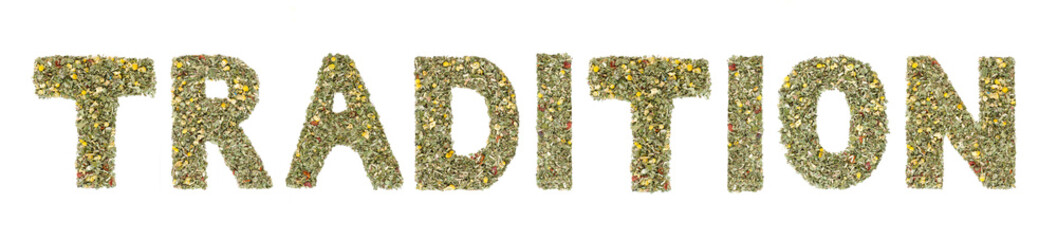 Word TRADITION spelled out with  herbs and tea leaves