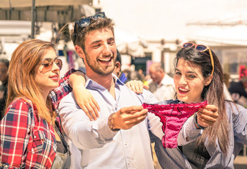 Group of happy young people at the weekly clothes market