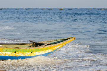 colorful wooden fishing boat on sea