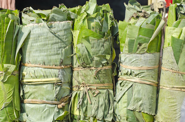wrapped banana leaves in asian market, India