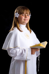 Portrait of smiling young brunette girl in first communion time