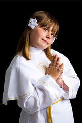 First communion for cute brunette girl