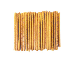 Salted sticks arranged vertically isolated on white