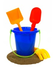 Toy sand pail with shovels and rake