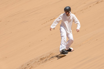 Man enjoying sandboarding