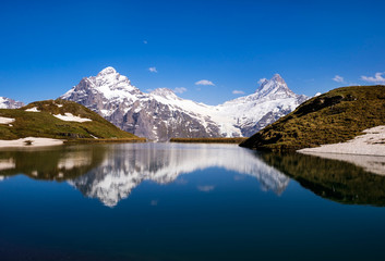 Wetterhorn and Schreckhorn peaks reflected in Bachalpsee.