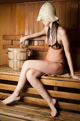 Pretty girl in sauna