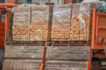 clay building bricks delivered to the job site in pallets