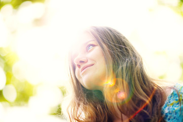 Young woman smiling in sunlight portrait
