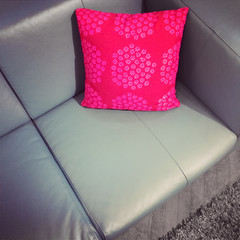 Leather sofa with red cushion
