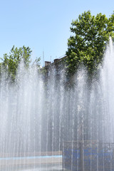 Fountain spray shooting high in  sky