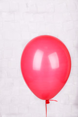 Color balloon on grey wall background