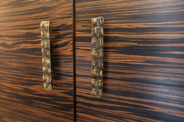 Two wooden drawers with rustic metal handles - detail