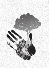 black tree silhouette on handprint