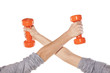 Two boys' hands holding weights