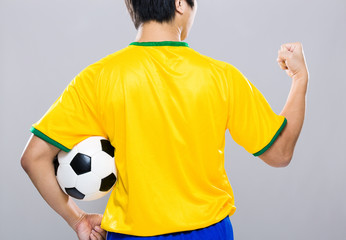 Back view of Brazil football player fist up