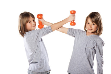 two twin brothers lift weights