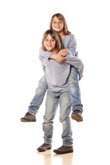 boy carries on his back his twin brother