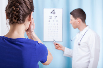 Young ophthalmologist performs eye examination