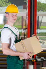 Warehouse worker holding box