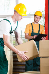 Supervisor and warehouse worker during job