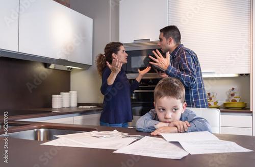Fototapeta Sad child suffering and parents having discussion
