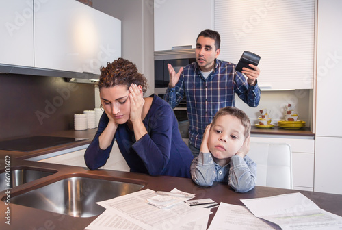 Worried mother suffering while father scream - 66208602