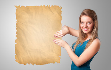 Young girl presenting old paper copy space