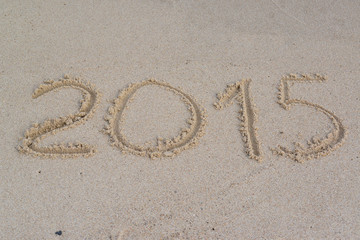 "Inscription ""2015"" on a sandy beach"