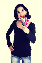 Make-up artist holding brushes