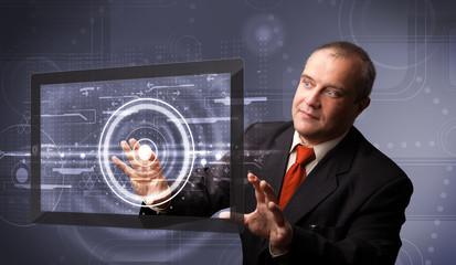 Businessman touching modern technology tablet