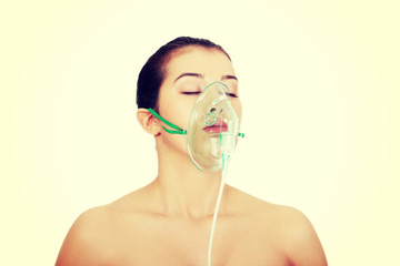 Diseased female patient wearing a oxygen mask