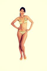 Full portrait of dark skined girl in bikini
