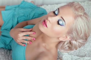 Makeup. Sensual beautiful woman model with eyes make up, posing