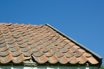 Broken tiled roof