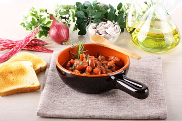 Bean soup in terracotta bowl