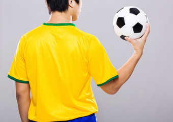 Man hold soccer ball on hand palm