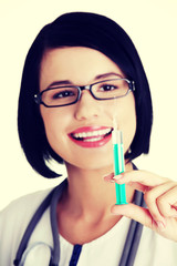 Happy medical doctor or nurse with syringe