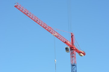Large red and blue crane with blue sky